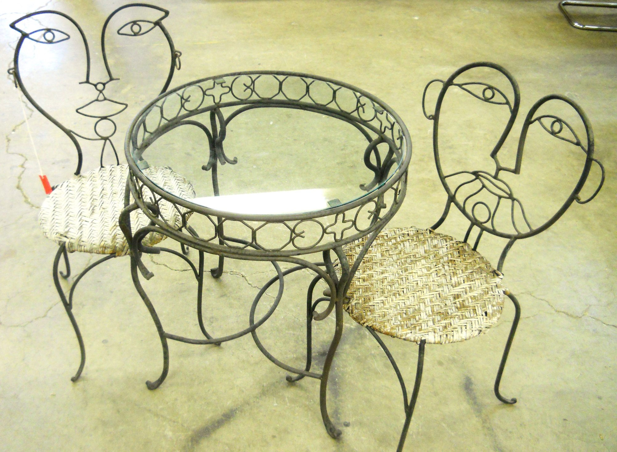 1 13965 His And Hers Picasso Inspired Wrought Iron Chairs
