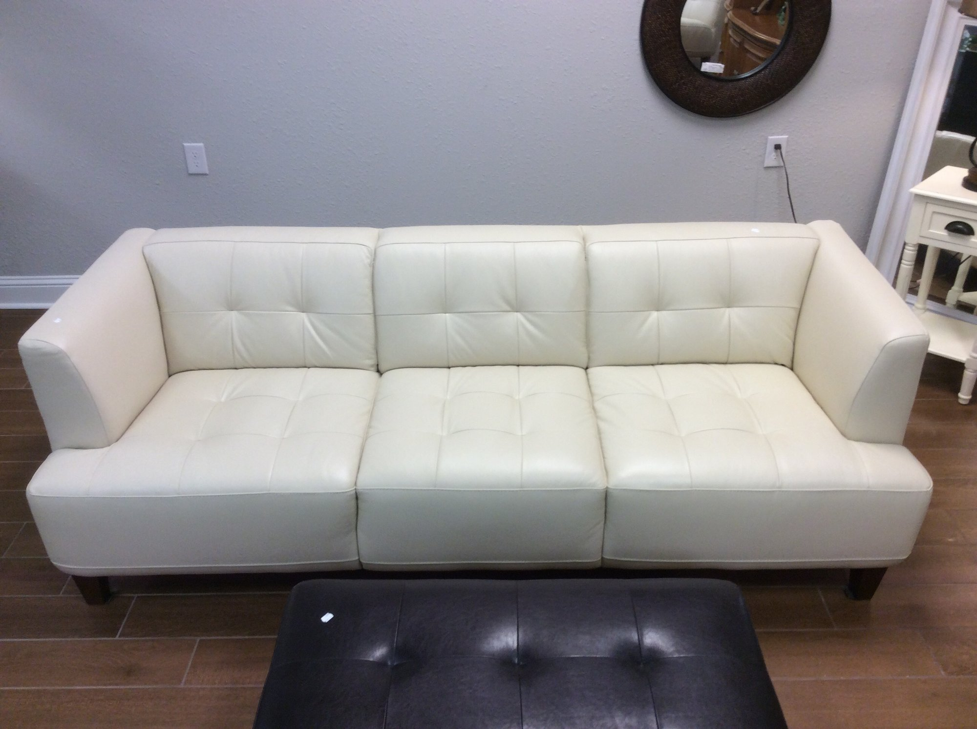 This elegant, tufted leather sofa is in excellent condition. The cream colored leather is incredibly soft and supple.<br /> None of the cushions are removable, so you&#039;ll never lose your change in this sofa! There is also a matching chaise lounge, that is available for purchase seperately