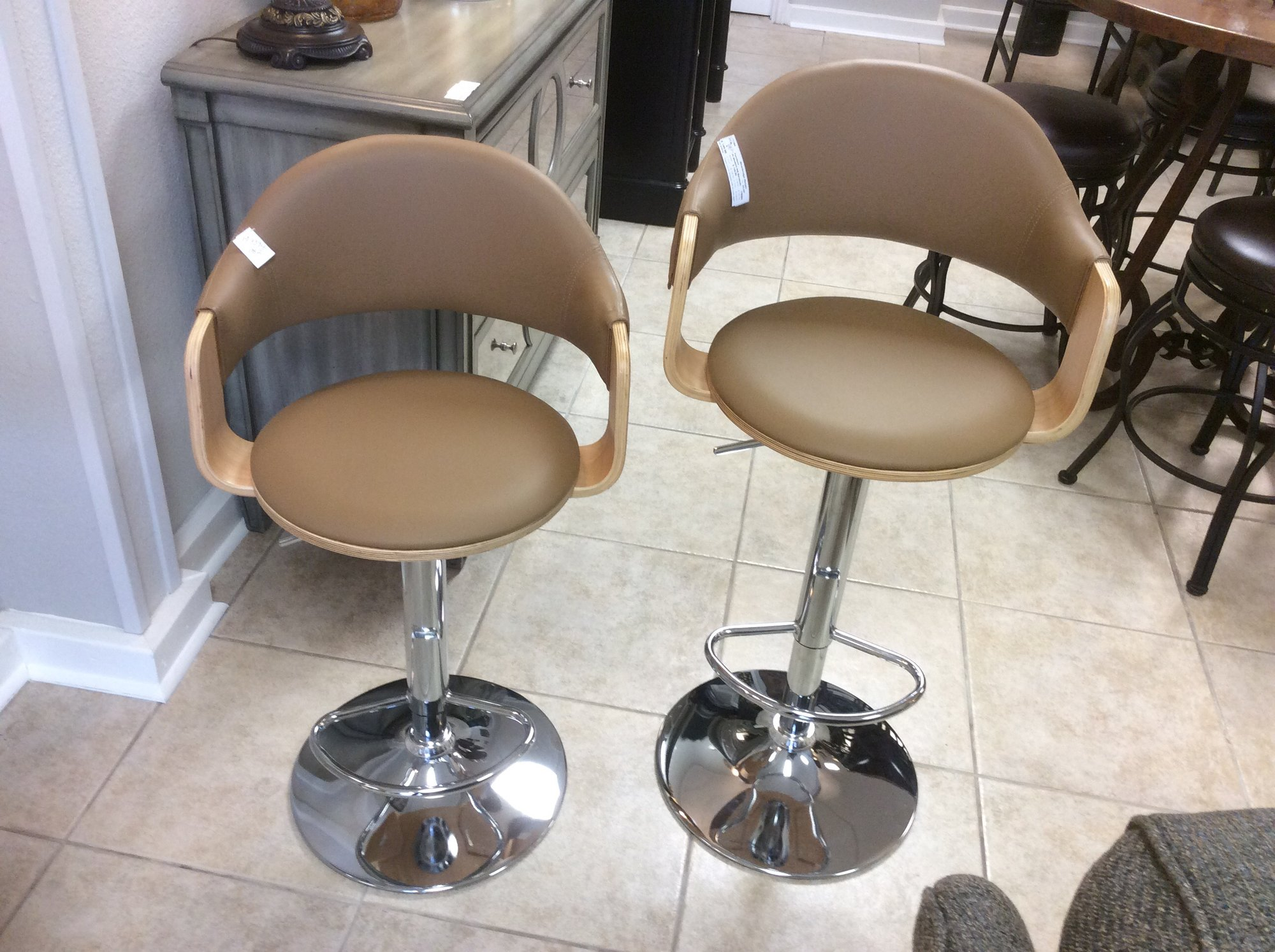 "These ultra-modern, adjustable barstools look brand new. In their lowest position, they measure 23"" tall, and in their highest position, they are 32"" tall. Great price for so much versatility!"