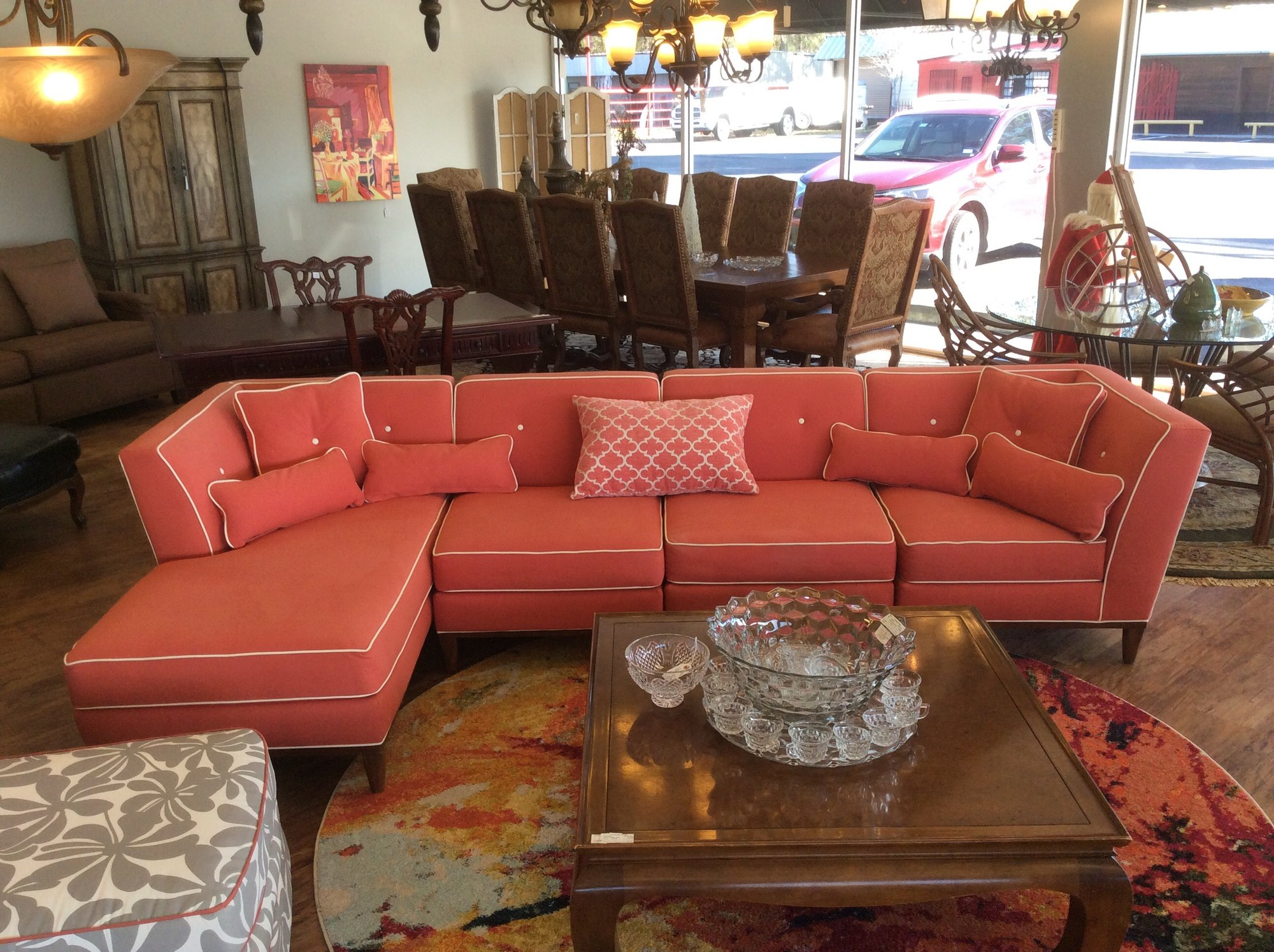 Oh my gosh, this is so FUN! This sectional sofa has 4 seperate pieces, so can be moved easily. The bright coral colored upholstery is a thick, sturdy denim-like fabric, and is in fabulous condition. Stop by and see it for yourself.