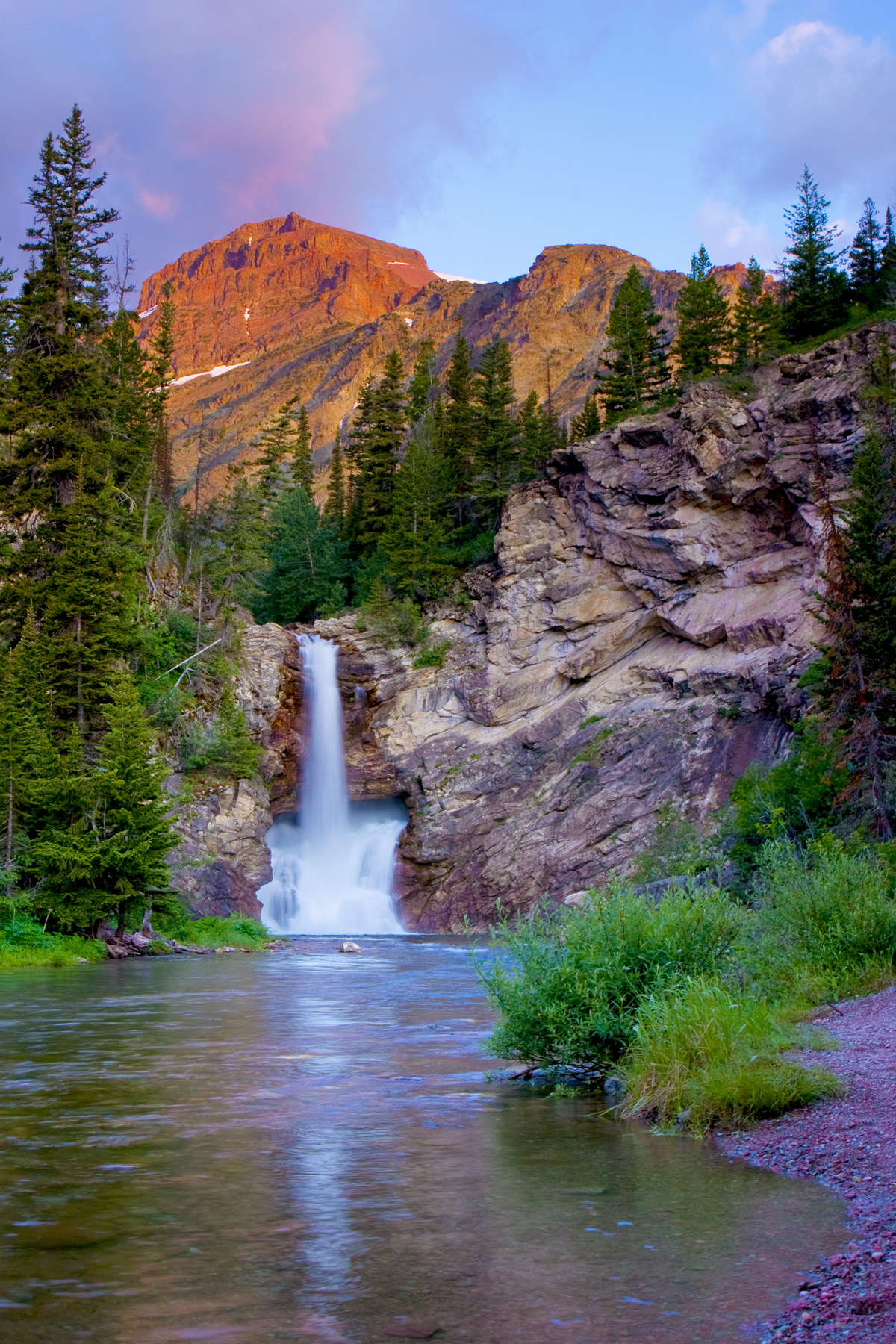 Running Eagle Falls is 10 miles north of East Glacier at Lower Two Medicine.  It is named Running Eagle after a Blackfoot woman warrior.  The story comes with your purchase.  This is #30 of 100 giclee print 16x24.<br /> <br /> Shipping is included.<br /> Please allow two weeks for shipment.