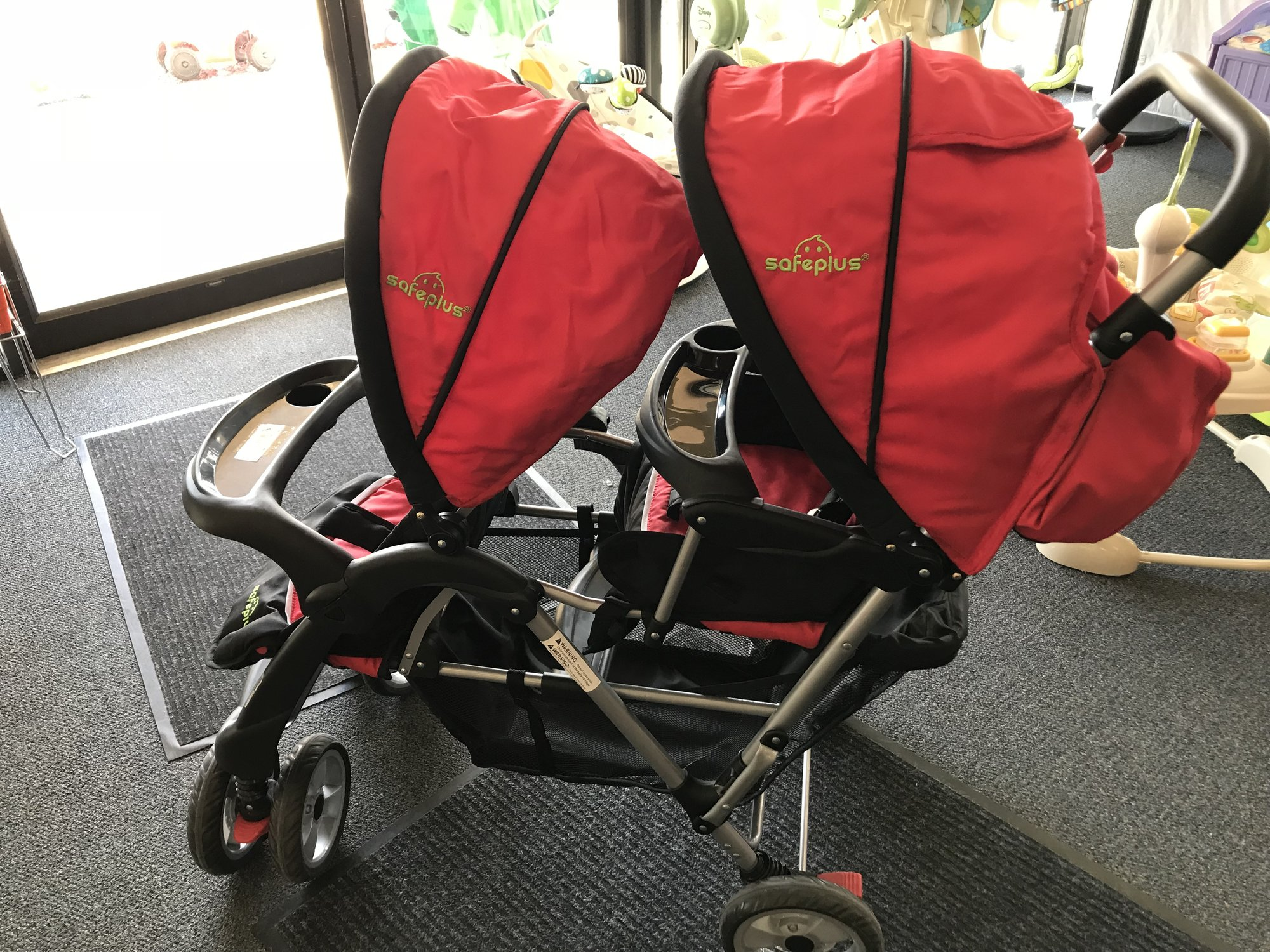 SafePlus barnd double stroller in excellent condition, looks ike it was barely used.  Has reclining seats and double canopies.  NO SHIPPING-in store pick up only