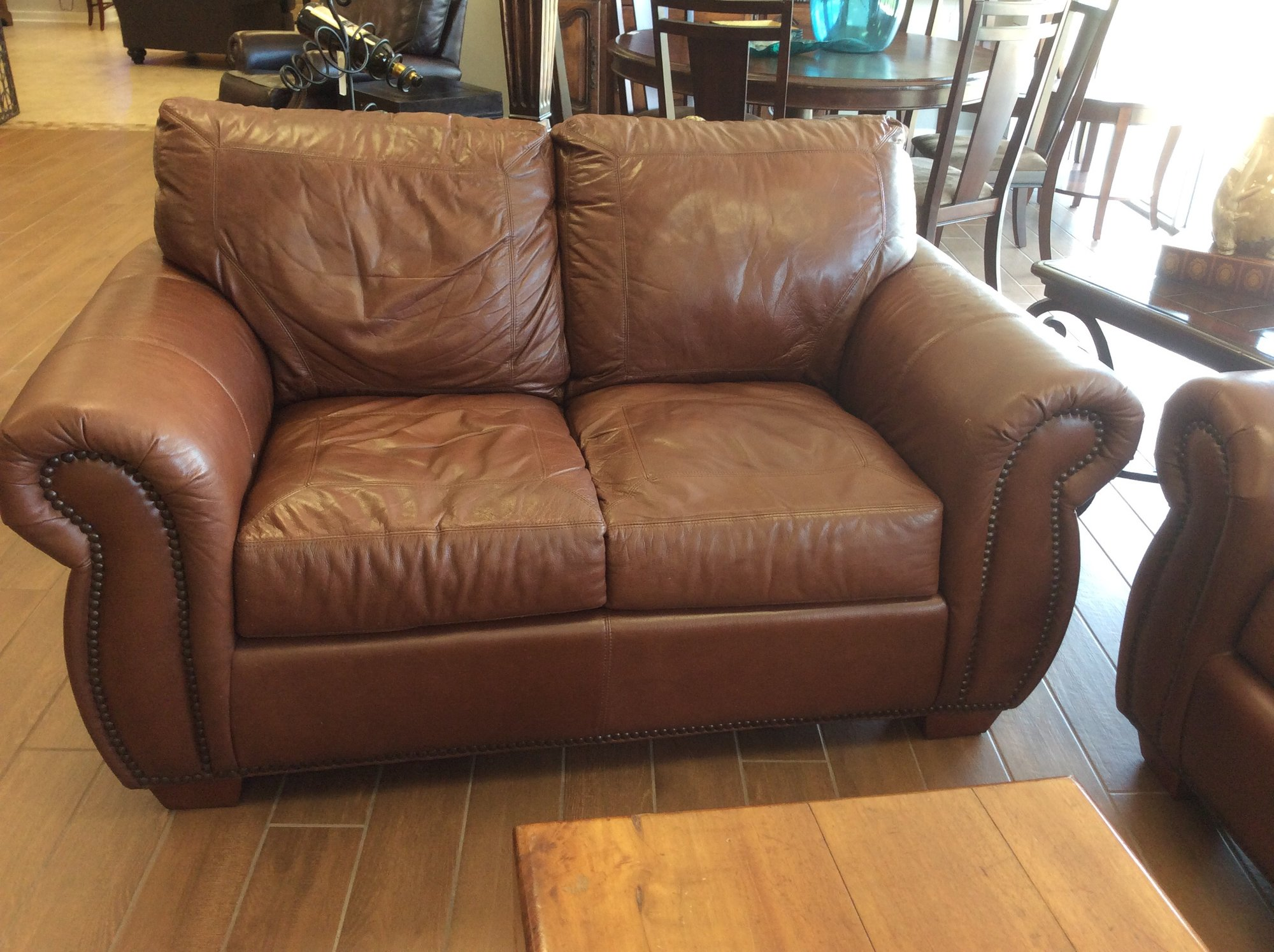 This Handsome Loveseat Features Soft Leather Upholstery, 2 Permanent Back